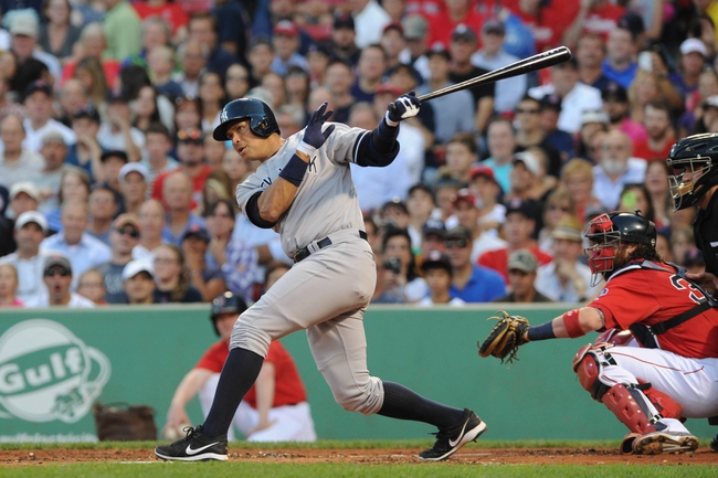 Aug 16, 2013; Boston, MA, USA; New York Yankees third baseman Alex Rodriguez (13) hits into a double play during the first inning against the Boston Red Sox at Fenway Park. Mandatory Credit: Bob DeChiara-USA TODAY Sports
