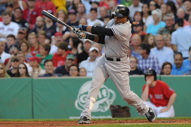 Aug 16, 2013; Boston, MA, USA; New York Yankees second baseman Robinson Cano (24) bats during the first inning against the Boston Red Sox at Fenway Park. Mandatory Credit: Bob DeChiara-USA TODAY Sports