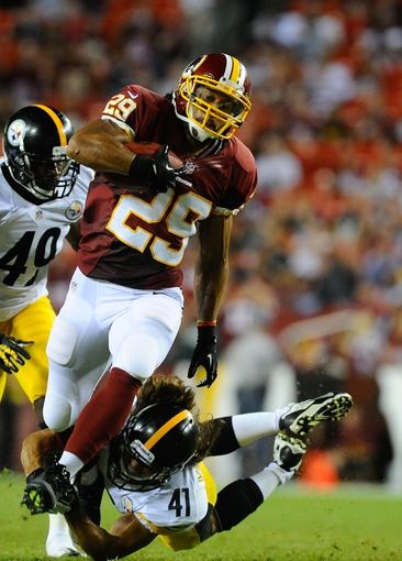 Aug 19, 2013; Landover, MD, USA; Washington Redskins running back Roy Helu (29) avoids the tackle by Pittsburgh Steelers defensive back Ross Ventrone (41) during the second half against the Pittsburgh Steelers at FedEX Field. Mandatory Credit: Brad Mills-USA TODAY Sports