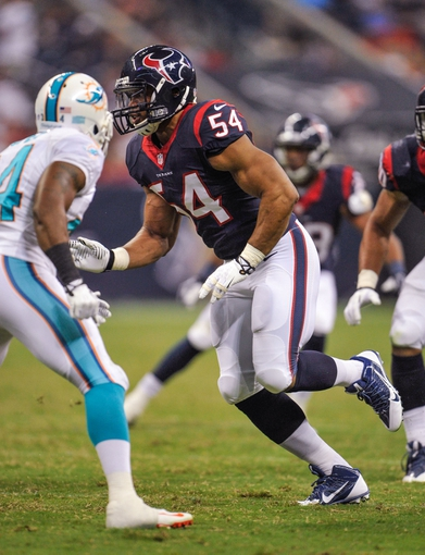 Aug 17, 2013; Houston, TX, USA; Houston Texans linebacker Trevardo Williams (54) during the game between the Texans and the Miami Dolphins at Reliant Stadium. The Texans defeated the Dolphins 24-17. Mandatory Credit: Jerome Miron-USA TODAY Sports