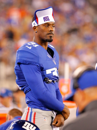 Aug 18, 2013; East Rutherford, NJ, USA; New York Giants cornerback Aaron Ross (31) during the second half against the Indianapolis Colts at MetLife Stadium. Indianapolis Colts defeat the New York Giants 20-12. Mandatory Credit: Jim O'Connor-USA TODAY Sports