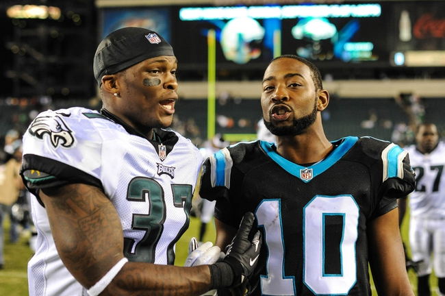 Aug 15, 2013; Philadelphia, PA, USA; Philadelphia Eagles defensive back Eddie Whitley (37) and Carolina Panthers wide receiver James Shaw (10) after the game at Lincoln Financial Field. The Philadelphia Eagles beat the Carolina Panthers 14-9. Mandatory Credit: John Geliebter-USA TODAY Sports