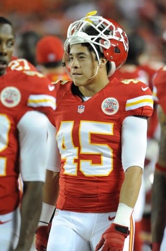 Aug 16, 2013; Kansas City, MO, USA; Kansas City Chiefs defensive back Greg Castillo (45) watches play on the sidelines during the second half of the game against the San Francisco 49ers at Arrowhead Stadium. San Francisco won 15-13. Mandatory Credit: Denny Medley-USA TODAY Sports