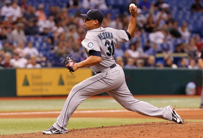 Aug 14, 2013; St. Petersburg, FL, USA; Seattle Mariners relief pitcher Yoervis Medina (31) throws a pitch against the Tampa Bay Rays at Tropicana Field. Tampa Bay Rays defeated the Seattle Mariners 5-4. Mandatory Credit: Kim Klement-USA TODAY Sports