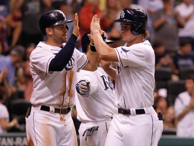 Aug 14, 2013; St. Petersburg, FL, USA; Tampa Bay Rays right fielder Wil Myers (9) is congratulated by third baseman Evan Longoria (3) and shortstop Yunel Escobar (11) after he hit a 2-run home run during the sixth inning against the Seattle Mariners at Tropicana Field. Tampa Bay Rays defeated the Seattle Mariners 5-4. Mandatory Credit: Kim Klement-USA TODAY Sports