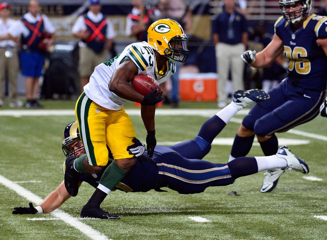 Aug 17, 2013; St. Louis, MO, USA; Green Bay Packers running back Johnathan Franklin (23) attempts to avoid St. Louis Rams running back Eric Stevens (47) during the second half at the Edward Jones Dome. Mandatory Credit: Scott Rovak-USA TODAY Sports