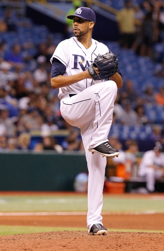 Aug 14, 2013; St. Petersburg, FL, USA; Tampa Bay Rays starting pitcher David Price (14) throws a pitch against the Seattle Mariners at Tropicana Field. Tampa Bay Rays defeated the Seattle Mariners 5-4. Mandatory Credit: Kim Klement-USA TODAY Sports