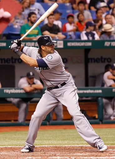 Aug 14, 2013; St. Petersburg, FL, USA; Seattle Mariners right fielder Michael Morse (38) at bat against the Tampa Bay Rays at Tropicana Field. Tampa Bay Rays defeated the Seattle Mariners 5-4. Mandatory Credit: Kim Klement-USA TODAY Sports