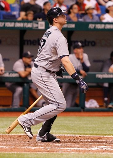 Aug 14, 2013; St. Petersburg, FL, USA; Seattle Mariners first baseman Justin Smoak (17) at bat against the Tampa Bay Rays at Tropicana Field. Tampa Bay Rays defeated the Seattle Mariners 5-4. Mandatory Credit: Kim Klement-USA TODAY Sports