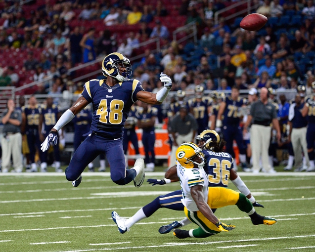 Aug 17, 2013; St. Louis, MO, USA; St. Louis Rams strong safety Rashard Hall (48) misses a pass intended for Green Bay Packers wide receiver Omarius Hines (5) during the second half at the Edward Jones Dome. Mandatory Credit: Scott Rovak-USA TODAY Sports