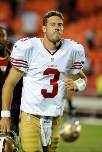 Aug 16, 2013; Kansas City, MO, USA; San Francisco 49ers quarterback Scott Tolzien (3) leaves the field after the game against the Kansas City Chiefs at Arrowhead Stadium. San Francisco won the game 15-13. Mandatory Credit: John Rieger-USA TODAY Sports