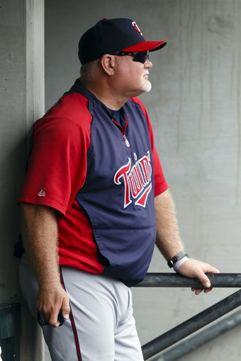 Aug 22, 2013; Detroit, MI, USA; Minnesota Twins manager Ron Gardenhire (35) watches from the dugout in the eighth inning against the Detroit Tigers at Comerica Park. Mandatory Credit: Rick Osentoski-USA TODAY Sports