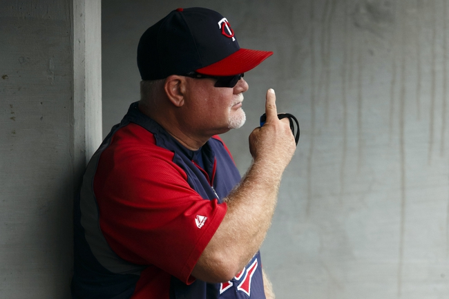 Aug 22, 2013; Detroit, MI, USA; Minnesota Twins manager Ron Gardenhire (35) gives signals from the dugout in the eighth inning against the Detroit Tigers at Comerica Park. Mandatory Credit: Rick Osentoski-USA TODAY Sports