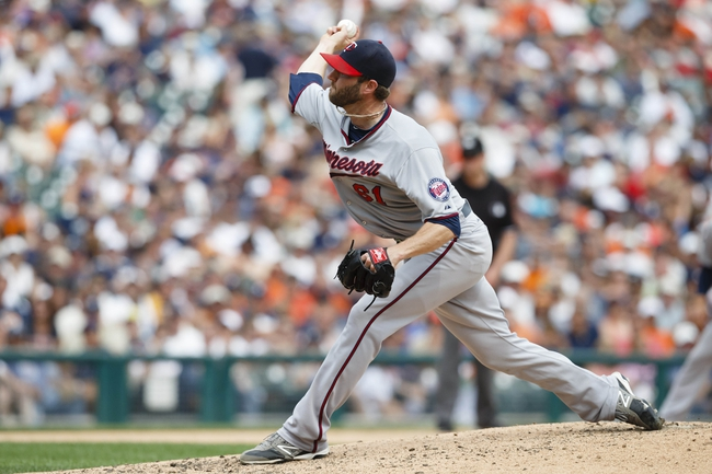 Aug 22, 2013; Detroit, MI, USA; Minnesota Twins relief pitcher Jared Burton (61) pitches in the eighth inning against the Detroit Tigers at Comerica Park. Minnesota  won 7-6. Mandatory Credit: Rick Osentoski-USA TODAY Sports
