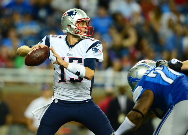 Aug 22, 2013; Detroit, MI, USA; New England Patriots quarterback Ryan Mallett (15) looks to pass in the third quarter of a preseason game against the Detroit Lions at Ford Field. Mandatory Credit: Andrew Weber-USA TODAY Sports