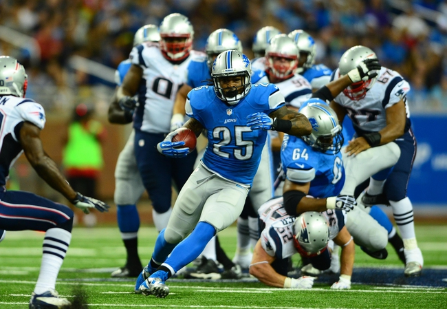 Aug 22, 2013; Detroit, MI, USA; Detroit Lions running back Mikel Leshoure (25) runs the ball in the third quarter of a preseason game against the New England Patriots at Ford Field. Mandatory Credit: Andrew Weber-USA TODAY Sports