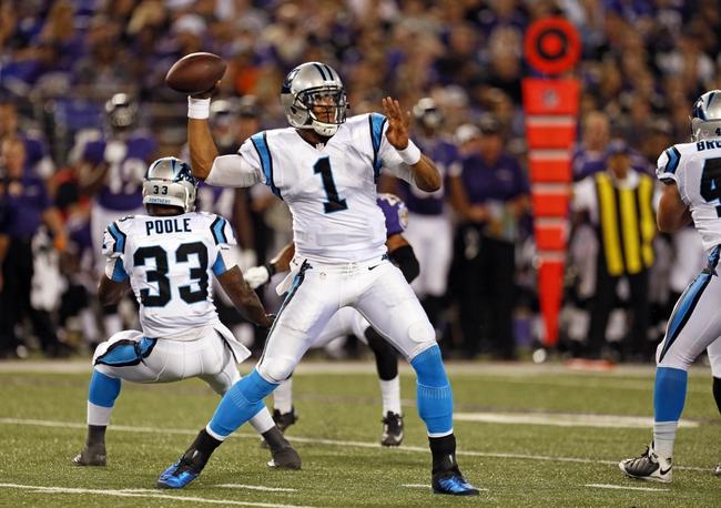 Aug 22, 2013; Baltimore, MD, USA; Carolina Panthers quarterback Cam Newton (1) drops back to pass against the Baltimore Ravens defense at M&T Bank Stadium. Mandatory Credit: Mitch Stringer-USA TODAY Sports