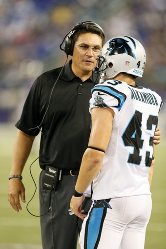 Aug 22, 2013; Baltimore, MD, USA; Carolina Panthers head coach Ron Rivera talks with safety Haruki Nakamura (43) during the game against the Baltimore Ravens at M&T Bank Stadium. Mandatory Credit: Mitch Stringer-USA TODAY Sports