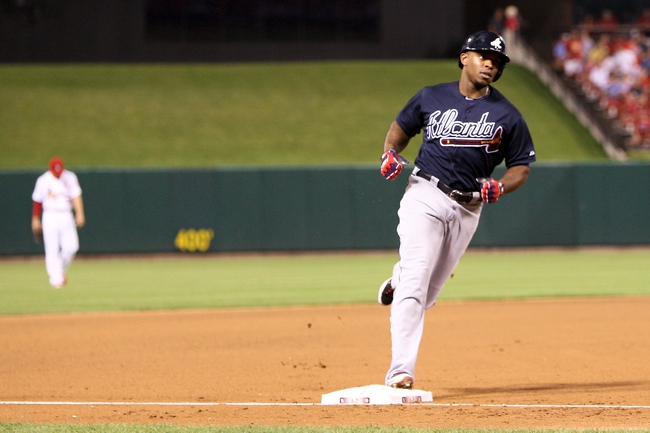 Aug 22, 2013; St. Louis, MO, USA; Atlanta Braves right fielder Justin Upton (8) rounds third base after hitting a two run home run in the fifth inning against the St. Louis Cardinals at Busch Stadium. Mandatory Credit: Scott Kane-USA TODAY Sports