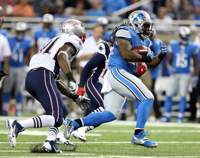 Aug 22, 2013; Detroit, MI, USA; Detroit Lions running back Mikel Leshoure (25) runs the ball against the New England Patriots during 2nd half at Ford Field. Lions won 40-9.  Mandatory Credit: Mike Carter-USA TODAY Sports