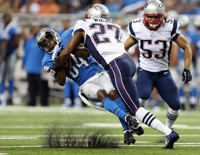 Aug 22, 2013; Detroit, MI, USA; Detroit Lions wide receiver Ryan Broyles (84) is tackled by New England Patriots strong safety Tavon Wilson (27) during 2nd half at Ford Field. Lions won 40-9.  Mandatory Credit: Mike Carter-USA TODAY Sports