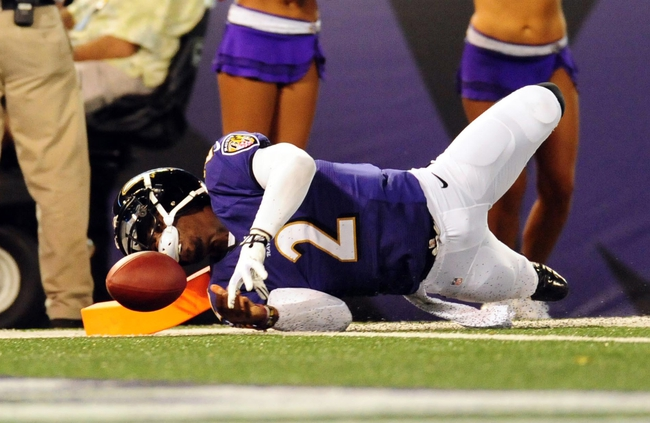 Aug 22, 2013; Baltimore, MD, USA; Baltimore Ravens quarterback Tyrod Taylor (2) dives for the end zone in the fourth quarter against the Carolina Panthers at M&T Bank Stadium. Mandatory Credit: Evan Habeeb-USA TODAY Sports