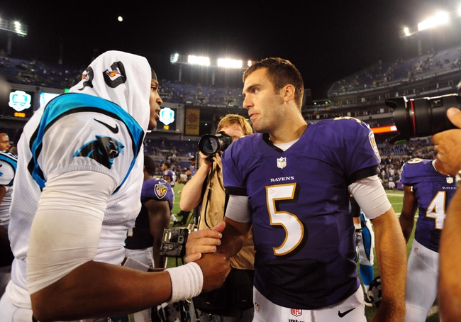 Aug 22, 2013; Baltimore, MD, USA; Baltimore Ravens quarterback Joe Flacco (5) shakes hands with Carolina Panthers quarterback Cam Newton (1) after the game at M&T Bank Stadium. Mandatory Credit: Evan Habeeb-USA TODAY Sports