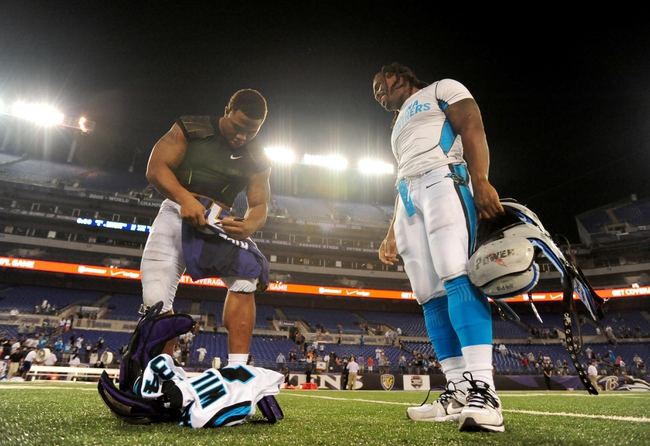 Aug 22, 2013; Baltimore, MD, USA; Baltimore Ravens running back Ray Rice (left) signs a jersey for Carolina Panthers running back DeAngelo Williams (right) at M&T Bank Stadium. Mandatory Credit: Evan Habeeb-USA TODAY Sports