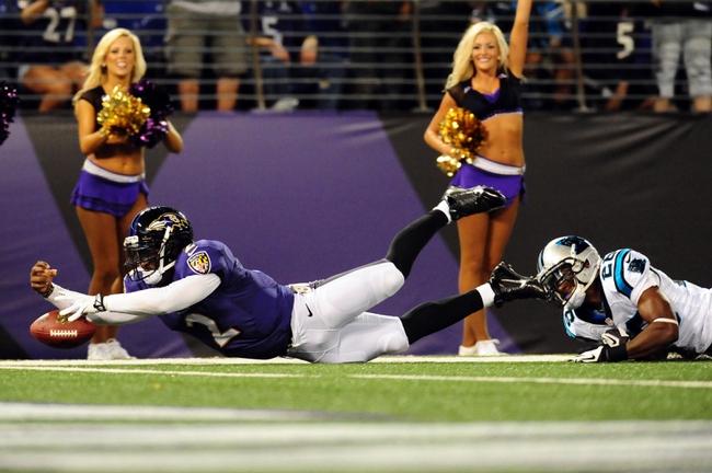 Aug 22, 2013; Baltimore, MD, USA; Baltimore Ravens quarterback Tyrod Taylor (2) dives for the end zone in front of Carolina Panthers cornerback Drayton Florence (29) at M&T Bank Stadium. Mandatory Credit: Evan Habeeb-USA TODAY Sports