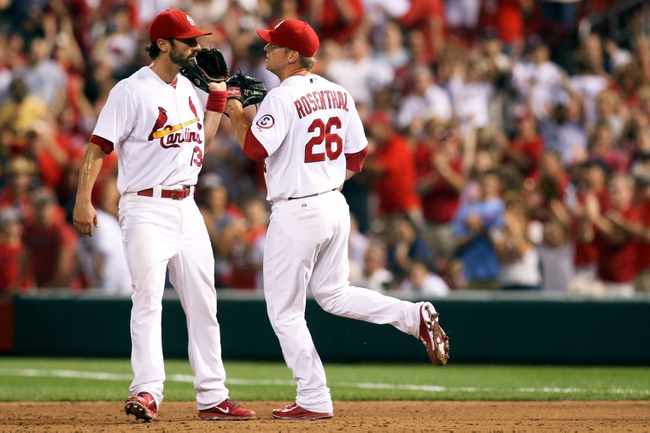 Aug 22, 2013; St. Louis, MO, USA; St. Louis Cardinals second baseman Matt Carpenter (13) and relief pitcher Trevor Rosenthal (26) congratulate each other after making the final out of the game against the Atlanta Braves at Busch Stadium. The Cardinals defeated the Braves 6-2. Mandatory Credit: Scott Kane-USA TODAY Sports