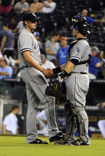 Aug 22, 2013; Kansas City, MO, USA; Chicago White Sox relief pitcher Addison Reed (43) celebrates with catcher Josh Phegley (36) after the game against the Kansas City Royals at Kauffman Stadium. Chicago won 4-3 in 12 innings. Mandatory Credit: John Rieger-USA TODAY Sports