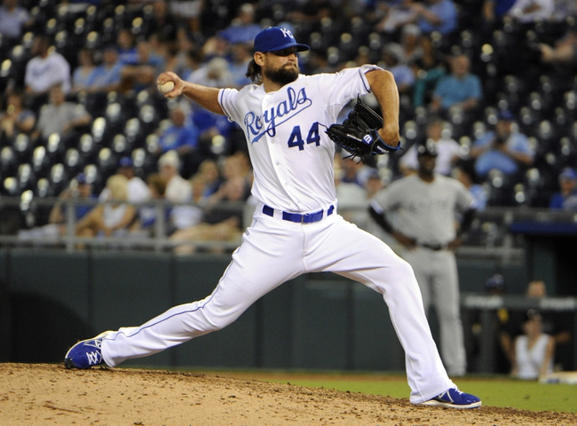Aug 22, 2013; Kansas City, MO, USA; Kansas City Royals relief pitcher Luke Hochevar (44) delivers a pitch in the eleventh inning against the Chicago White Sox at Kauffman Stadium. Chicago won 4-3 in 12 innings. Mandatory Credit: John Rieger-USA TODAY Sports