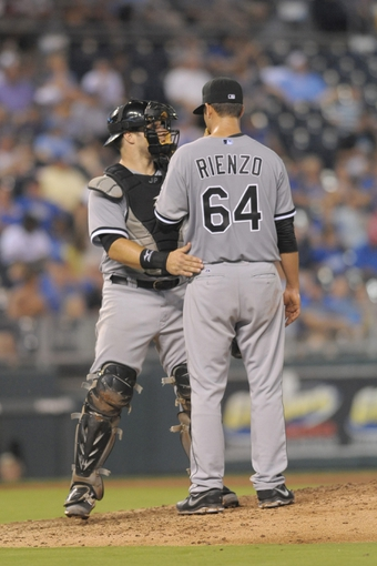 Aug 21, 2013; Kansas City, MO, USA; Chicago White Sox catcher Josh Phegley (36) makes a visit to talk with starting pitcher Andre Rienzo (64) in the sixth inning of the game against the Kansas City Royals at Kauffman Stadium. Chicago won 5-2. Mandatory Credit: Denny Medley-USA TODAY Sports