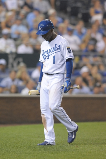 Aug 21, 2013; Kansas City, MO, USA; Kansas City Royals center fielder Jarrod Dyson (1) walks to the dugout after striking out in the sixth inning of the game against the Chicago White Sox at Kauffman Stadium. Chicago won 5-2. Mandatory Credit: Denny Medley-USA TODAY Sports
