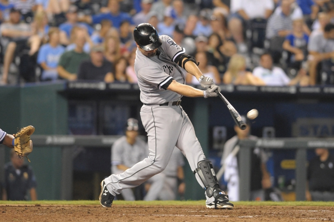 Aug 21, 2013; Kansas City, MO, USA; Chicago White Sox first baseman Paul Konerko (14) at bat during the sixth inning of the game against the Kansas City Royals at Kauffman Stadium. Chicago won 5-2. Mandatory Credit: Denny Medley-USA TODAY Sports