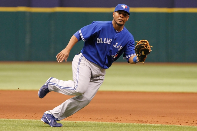 Aug 18, 2013; St. Petersburg, FL, USA; Toronto Blue Jays first baseman Edwin Encarnacion (10) runs to first to force an out against the Tampa Bay Rays at Tropicana Field. Tampa Bay Rays defeated the Toronto Blue Jays 2-1. Mandatory Credit: Kim Klement-USA TODAY Sports