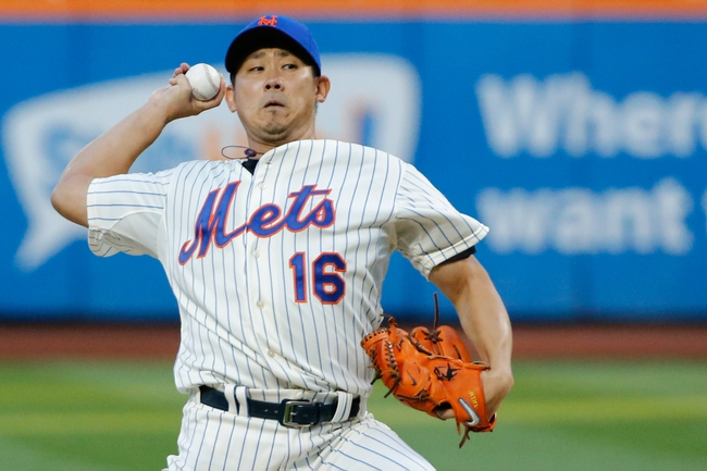 Aug 23, 2013; New York, NY, USA;  New York Mets starting pitcher Daisuke Matsuzaka (16) pitches during the first inning against the Detroit Tigers at Citi Field.  Mandatory Credit: Anthony Gruppuso-USA TODAY Sports