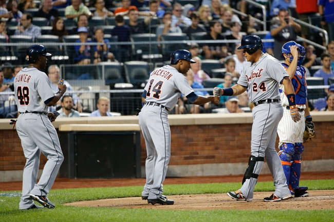 Aug 23, 2013; New York, NY, USA;  Detroit Tigers third baseman Miguel Cabrera (24) celebrates scoring with center fielder Austin Jackson (14) and right fielder Torii Hunter (48) during the second inning against the New York Mets at Citi Field.  Mandatory Credit: Anthony Gruppuso-USA TODAY Sports