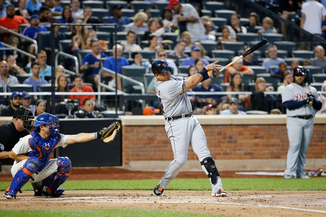 Aug 23, 2013; New York, NY, USA; Detroit Tigers third baseman Miguel Cabrera (24) hits a home run to left allowing two runners to score during the second inning against the New York Mets at Citi Field.  Mandatory Credit: Anthony Gruppuso-USA TODAY Sports