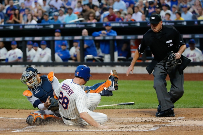 Aug 23, 2013; New York, NY, USA;  New York Mets second baseman Daniel Murphy (28) slides safe as Detroit Tigers catcher Victor Martinez (41) is late with the tag during the first inning at Citi Field.  Mandatory Credit: Anthony Gruppuso-USA TODAY Sports