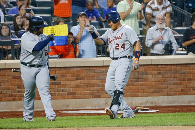 Aug 23, 2013; New York, NY, USA;  Detroit Tigers first baseman Prince Fielder (28) acknowledges the three run home run by third baseman Miguel Cabrera (24) during the second inning at Citi Field.  Mandatory Credit: Anthony Gruppuso-USA TODAY Sports