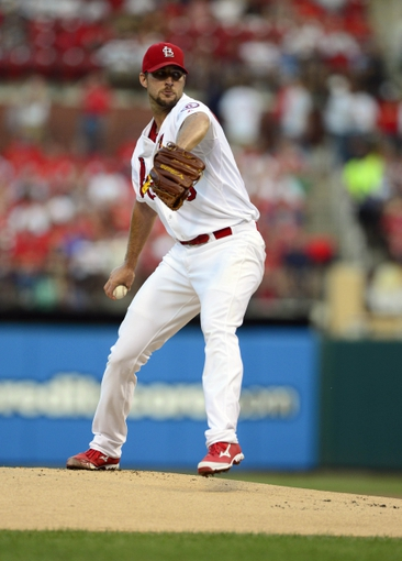 Aug 23, 2013; St. Louis, MO, USA; St. Louis Cardinals starting pitcher Adam Wainwright (50) throws to a Atlanta Braves batter during the first inning at Busch Stadium. Mandatory Credit: Jeff Curry-USA TODAY Sports
