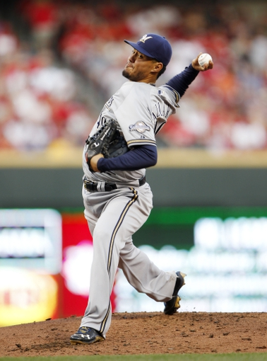 Aug 23, 2013; Cincinnati, OH, USA; Milwaukee Brewers starting pitcher Yovani Gallardo (49) pitches during the second inning against the Cincinnati Reds at Great American Ball Park. Mandatory Credit: Frank Victores-USA TODAY Sports