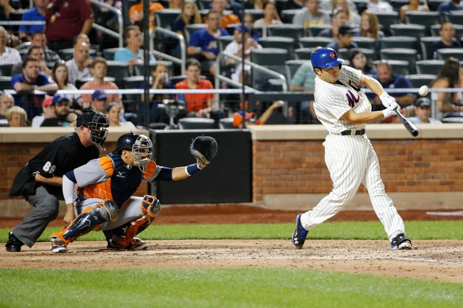 Aug 23, 2013; New York, NY, USA;  New York Mets catcher Travis d'Arnaud (15) flies out to left during the fourth inning against the Detroit Tigers at Citi Field.  Mandatory Credit: Anthony Gruppuso-USA TODAY Sports