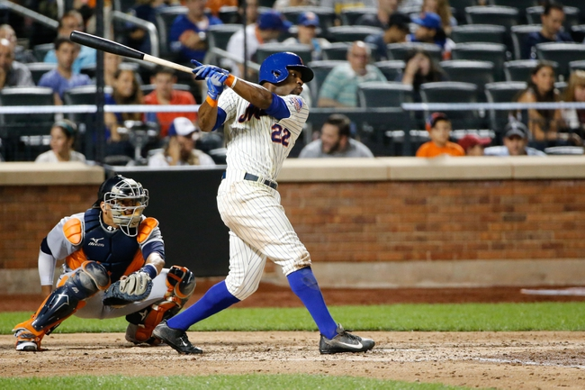 Aug 23, 2013; New York, NY, USA;  New York Mets left fielder Eric Young Jr. (22) singles to center during the fifth inning against the Detroit Tigers at Citi Field.  Mandatory Credit: Anthony Gruppuso-USA TODAY Sports