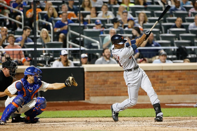 Aug 23, 2013; New York, NY, USA; Detroit Tigers center fielder Austin Jackson (14) hits a home run to left during the seventh inning against the New York Mets at Citi Field.  Mandatory Credit: Anthony Gruppuso-USA TODAY Sports
