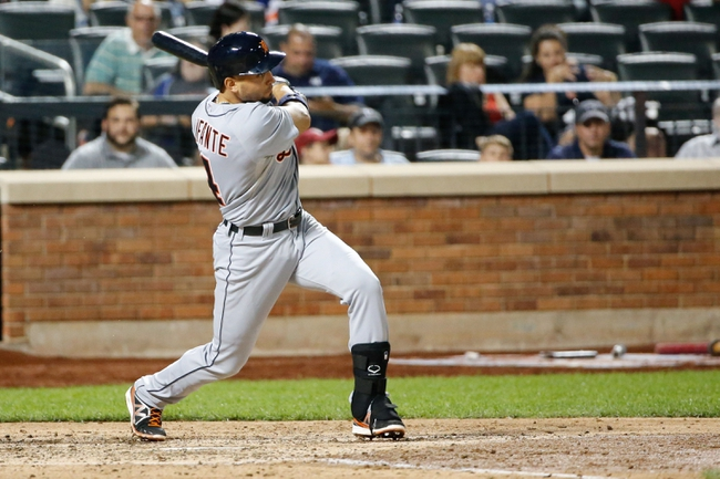 Aug 23, 2013; New York, NY, USA;  Detroit Tigers second baseman Omar Infante (4) singles to left during the sixth inning against the New York Mets at Citi Field.  Mandatory Credit: Anthony Gruppuso-USA TODAY Sports