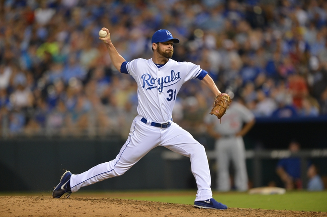 Aug 23, 2013; Kansas City, MO, USA; Kansas City Royals pitcher Louis Coleman (31) delivers a pitch against the Washington Nationals during the fourth inning at Kauffman Stadium.  Mandatory Credit: Peter G. Aiken-USA TODAY Sports