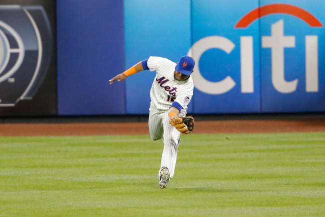 Aug 23, 2013; New York, NY, USA;  New York Mets center fielder Juan Lagares (12) leaps for the catch during the ninth inning against the Detroit Tigers at Citi Field.  Tigers won 6-1.  Mandatory Credit: Anthony Gruppuso-USA TODAY Sports
