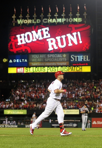 Aug 23, 2013; St. Louis, MO, USA; St. Louis Cardinals left fielder Matt Holliday (7) runs the bases after hitting a solo home run off of Atlanta Braves starting pitcher Kris Medlen (54) during the sixth inning at Busch Stadium. Mandatory Credit: Jeff Curry-USA TODAY Sports